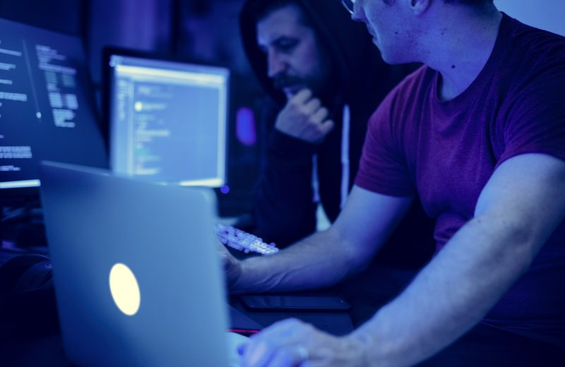 programmers working on computer program PHWV94T